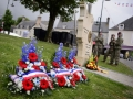 Wreaths rest on the ground in front of the Alexandre Renaud Memorial in Sainte-Mere-Eglise, France prior to a ceremony on May 31, 2018.