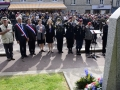 Attendees salute while the U.S. National Anthem plays at the Airborne Memorial during a ceremony honoring the paratroopers who fought to liberate the city on D-Day in Sainte-Mere-Eglise, France on May 31, 2018.